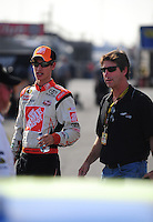 Oct. 9, 2009; Fontana, CA, USA; NASCAR Sprint Cup Series driver Joey Logano (left) with father Tom Logano during qualifying for the Pepsi 500 at Auto Club Speedway. Mandatory Credit: Mark J. Rebilas-