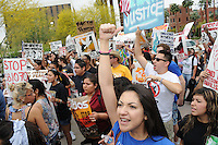 Phoenix, Arizona. April 25, 2012 - Daniela Cruz, one of the undocumented students arrested on March 20, 2012, takes part of a protest outside the U.S. Immigration and Customs Enforcement building near downtown Phoenix. About 500 people protested the controversial SB 1070 immigration law on the same day U.S. Supreme Court justices heard legal arguments on the Arizona vs. United States case. At the end of the march, six activists blocked Central Avenue by sitting in the middle of the street. They all were arrested by the Phoenix Police Department and taken to the Fourth Avenue County Jail. Daniela Cruz has become an outspoken activist to advocate for passage of the DREAM Act which would allow her and about 1 million individual to obtain a path for legalization. Photo by Eduardo Barraza © 2012