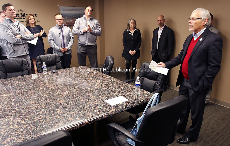 TORRINGTON CT. 14 November 2016-110816SV07-Don Mroz, president of Post University and vice chair of United Way Greater Waterbury welcomes visitors from St. Mary&rsquo;s Hospital and Trinity Health-New England to the United Way offices in Waterbury Monday.<br /> Steven Valenti Republican-American