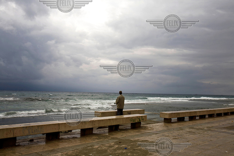 A man looks out to sea on the corniche in Benghazi. On 17 February 2011 Libya saw the beginnings of a revolution against the 41 year regime of Col Muammar Gaddafi.
