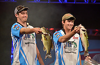 NWA Democrat-Gazette/BEN GOFF -- 04/26/15 Tyler Black  (left) and North Carolina teammate Kristopher Queen display two of their bass during weigh-in for the 2015 High School Fishing National Championship at the John Q. Hammons Center in Rogers on Sunday Apr. 26, 2015. Black and Queen were named 2015 champions after edging out the team from Oklahoma in final weigh-in.