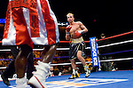 Uncasville, CT:  (r) Paulie Malignaggi  in the ring during his IBF Junior Welterweight Championship fight against Lovemore N'Dou at the Mohegan Sun Casino, June 16th, 2007. Malignaggi won the belt from N'Dou by unanimous decision.. Photo by Thierry Gourjon.