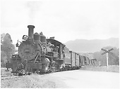 Leased D&amp;RGW #463 with a short freight, including automobiles, just west of Durango, CO.<br /> RGS  w. of Durango, CO  Taken by Richardson, Robert W. - 8/10/1949