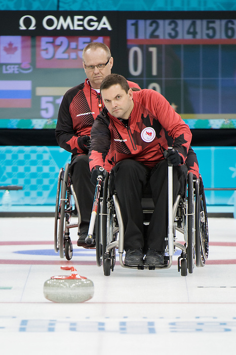 Sochi, RUSSIA - Mar 8 2014 -  Dennis Thiessen and Mark Ideson as Canada takes on Russia in Wheelchair Curling during the 2014 Paralympic Winter Games in Sochi, Russia.  (Photo: Matthew Murnaghan/Canadian Paralympic Committee)