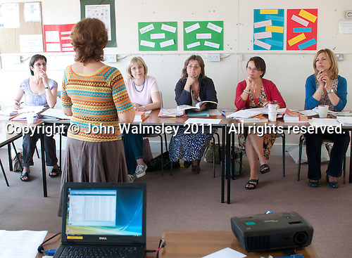 Students listening to the tutor, Spanish class, Adult Learning Centre, Guildford, Surrey.