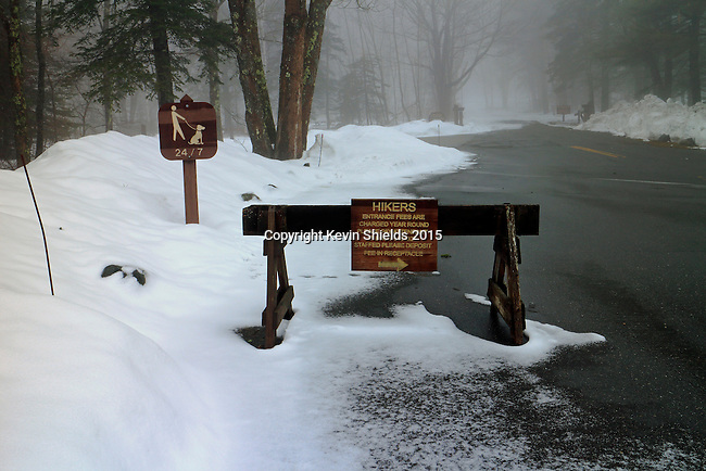Hikers sign in a campground in the late Winter, Camden, Maine.