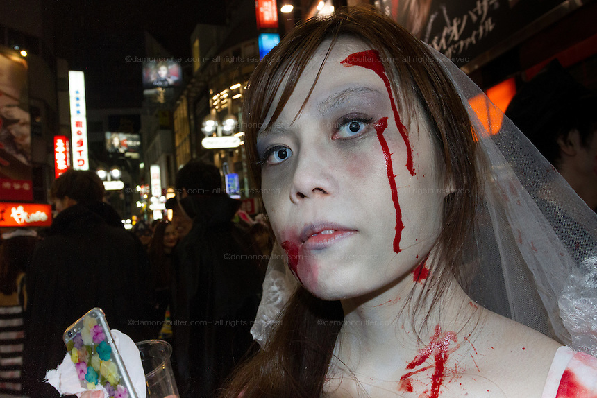 Portrait of a young Japanese reveller in the Halloween celebrations in Shibuya, Tokyo, Japan. Saturday October 29th 2016 Halloween celebration in Japan have grown massively in the last few years. To ensure the safety of the crowds in Shibuya this year, the police closed several roads leading to the famous Hachiko Square, allowing costumed revellers to spread over a larger area.