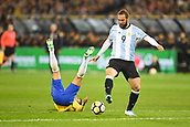 June 9th 2017, Melbourne Cricket Ground, Melbourne, Australia; International Football Friendly; Brazil versus Argentina; Gonzalo Higuain of Argentina kicks the ball as his opponent falls over