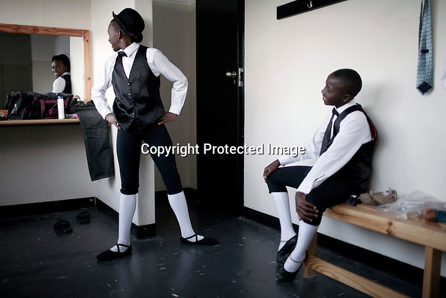 BERGFLIET SOUTH AFRICA - DECEMBER 11: Sikhumbuzo Hlahleni, age 15, a student at Cape Town City Ballet's youth concentrates backstage before a performance on December 11, 2010 in Bergfliet, South Africa. He trains in Cape Town every Saturday. He also trains a few days week at home in Khayelitsha, a poor township outside Cape Town. He has to change taxi three times to get to the school. He comes from a very poor family where the mother works as a domestic worker. (Photo by Per-Anders Pettersson)