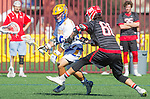 Santa Barbara, CA 04/16/16 - Wesley  Kim (UCSB #40) and Jeff  Shriver (Chapman #60) in action during the final regular MCLA SLC season game between Chapman and UC Santa Barbara.  Chapman defeated UCSB 15-8.