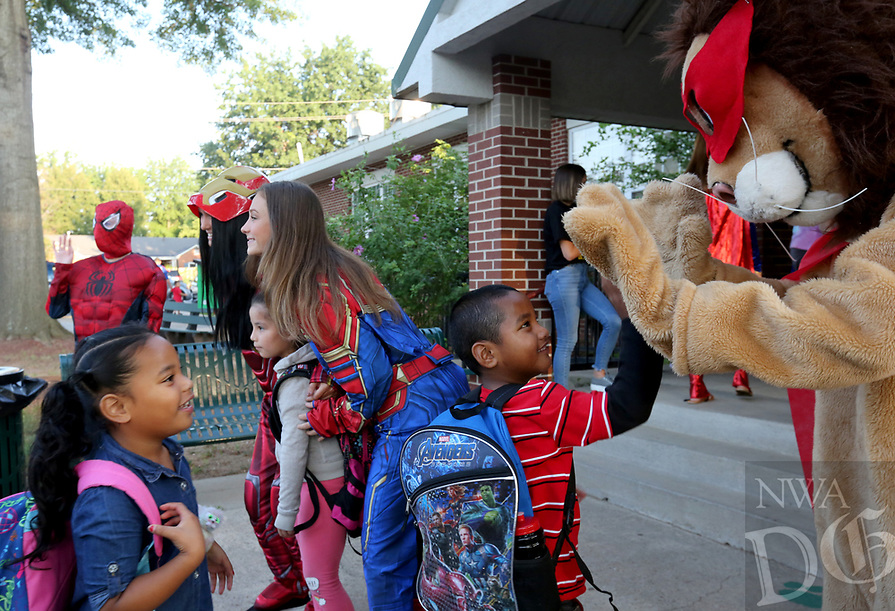 NWA Democrat-Gazette/DAVID GOTTSCHALK Lee the Lion (right) stands with costumed curriculum and instruction students with the University of Arkansas greet students and parents Tuesday, August 13, 2019, at Lee Elementary School in Springdale. Tuesday was the first day of the school year for the Springdale School District.