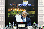 Palestinian Prime Minister Mohammad Ishtayeh chairs the weekly meeting of his government, in the West Bank city of Ramallah, August 05, 2019. Photo by Prime Minister Office