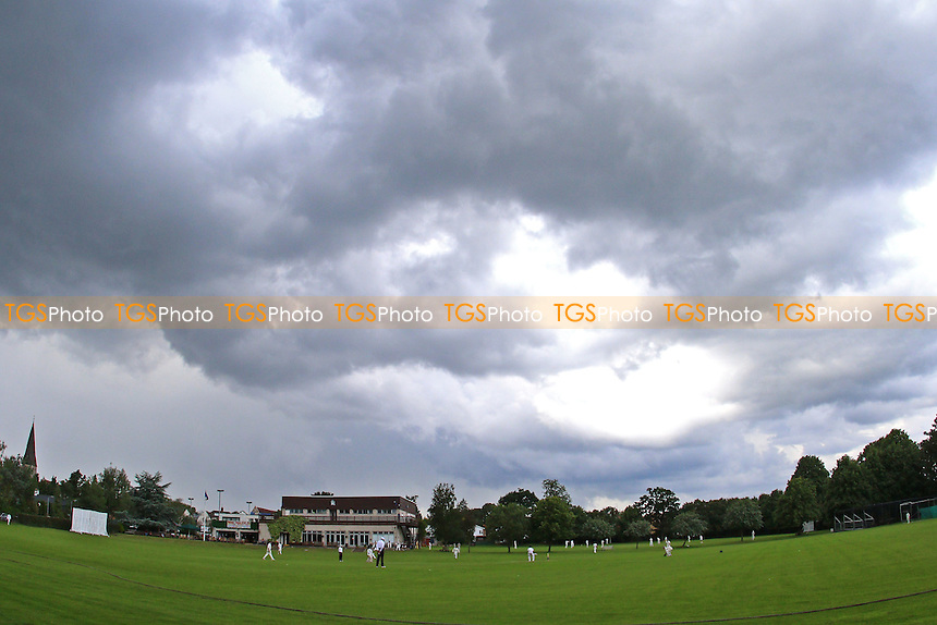 General view of dark clouds over the ground during Woodford Wells CC vs Upminster CC, Shepherd Neame Essex League Cricket at Monkhams Lane on 25th June 2016
