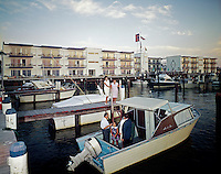 Harbor House Marina,Ocean City NJ. Couples meeting on a boat docked in the marina.