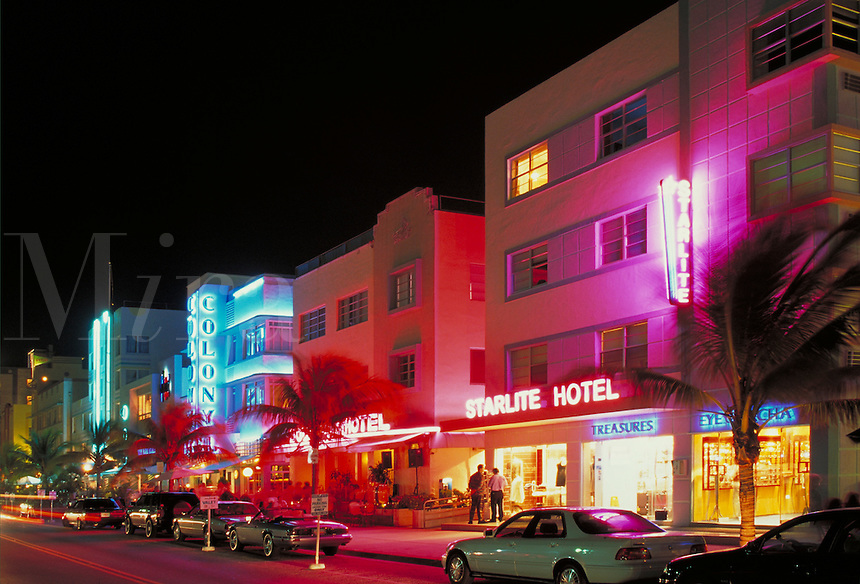 Ocean Drive alive at night, looking south from 8th Street. Ocean Drive, Miami Beach FL USA.