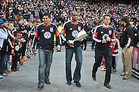 D.C. United former players from left to right Jaime Moreno, Eddie Pope and John harkes presenting the Eastern Conference Trophy. D.C. United tied The Houston Dynamo 1-1 but lost in the overall score 4-2 in the second leg of the Eastern Conference Championship at RFK Stadium, Sunday November 18, 2012.