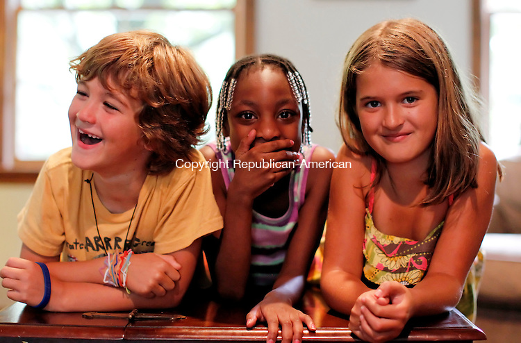 Southbury, CT-14, July 2010-071410CM10  Margy Dowleyne, (center) 8, of Brooklyn, NY jokes inside the living room of the Navas' home in Southbury.  Left is William Navas, 6, and Jacqueline Navas, 9.  Dowleyne spent a week with the Navas through the Fresh Air Fund. The agency, a not-for-profit, provides summer experiences for children.  Dowleyne had the opportunity to get away from the city life, and spend a week in the country.   --Christopher Massa Republican-American