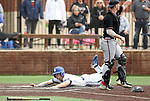 SIOUX FALLS, SD - APRIL 6: Nick Smith dives. Safely into home against Nebraska Omaha Saturday afternoon during their game in Sioux Falls.   (Photo by Dave Eggen/Inertia)