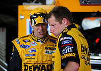 May 1, 2009; Richmond, VA, USA; Crew chief Drew Blickensderfer (right) talks with NASCAR Sprint Cup Series driver Matt Kenseth during practice for the Russ Friedman 400 at the Richmond International Raceway. Mandatory Credit: Mark J. Rebilas-