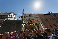 A mikoshi is carried through the streets during the Sanja matsuri, Asakusa, Tokyo, Japan. Sunday May 21st 2017. The Sanja matsuri (Three shrines festival) is one of the biggest Shinto festivals in Japan. It takes place for 3 days around the third weekend of May and features over 100 large and small mikoshi, or portable shrines, which are paraded around the streets of the historic Asakusa district in Tokyo. to bring blessings and good luck on the inhabitants. The events attracts up to 2 million visitors each year.