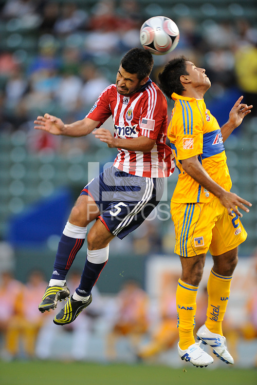 Chivas USA (5) Paulo Nagamura and UANLTigers (20) Bernardo Cabrera battle for a ball during a game at the Home Depot Center in Carson, CA on Saturday, June 20, 2009..