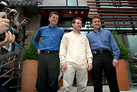 Montreal, June 5th 2001<br /> <br /> BAR team Formula One driver, JACQUES VILLENEUVE pose with business partners Jean-Pierre Da Costa Li and Martin Poitras in front of their new restaurant - dance club ``Newtown `` on Crescent Street in downtown, June 5th 2001 MONTREAL , Canada.<br /> Photo by Pierre Roussel / Getty Images (On spec.)<br /> NOTE : Nikon D-1 TIFF open with QImage ICC profile, save in Adobe 1998 RGB color space.