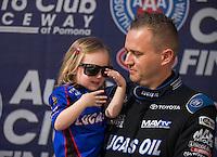 Nov 13, 2016; Pomona, CA, USA; NHRA top fuel driver Richie Crampton with his daughter during the Auto Club Finals at Auto Club Raceway at Pomona. Mandatory Credit: Mark J. Rebilas-USA TODAY Sports