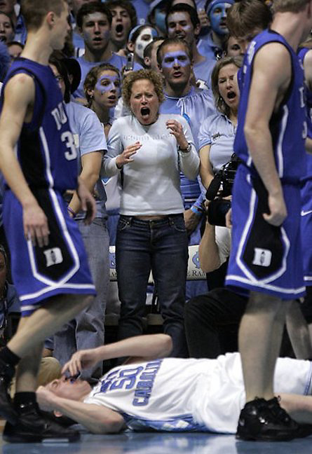 UNC fans react after a flagrant foul by Duke's Gerald Henderson that injured UNC's Tyler Hansbrough, bottom, at the Smith Center.