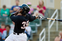 Keon Barnum (35) of the Kannapolis Intimidators follows through on his swing against the Greenville Drive at CMC-Northeast Stadium on June 29, 2013 in Kannapolis, North Carolina.  The Drive defeated the Intimidators 5-3.   (Brian Westerholt/Four Seam Images)