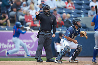 Home plate umpire Lance Seilhamer makes a strike call during the Midwest League game between the South Bend Cubs and the West Michigan Whitecaps at Fifth Third Ballpark on June 10, 2018 in Comstock Park, Michigan. The Cubs defeated the Whitecaps 5-4.  (Brian Westerholt/Four Seam Images)