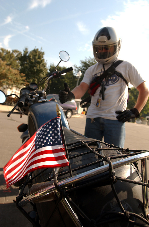 1flag091801 -- An American Flags adorns the motorcycle of Jay Russo, an ABC News courier.