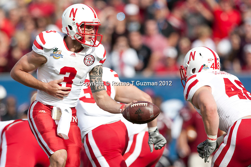 January 2, 2012: Nebraska quarterback Taylor Martinez (3) hands off to Nebraska fullback Tyler Legate (48) during first half game action in the Capital One Bowl between the Nebraska Cornhuskers and the South Carolina Gamecocks at the Citrus Bowl in Orlando, Fl.