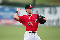 Kannapolis Intimidators third baseman Zach Remillard (23) warms-up between innings of the South Atlantic League game against the Charleston RiverDogs at Kannapolis Intimidators Stadium on August 3, 2016 in Kannapolis, North Carolina.  The Intimidators defeated the RiverDogs 8-4.  (Brian Westerholt/Four Seam Images)