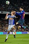 Lionel Messi of FC Barcelona (R) fights for the ball with Diego Javier Llorente of Real Sociedad (L) during the La Liga match between Barcelona and Real Sociedad at Camp Nou on May 20, 2018 in Barcelona, Spain. Photo by Vicens Gimenez / Power Sport Images