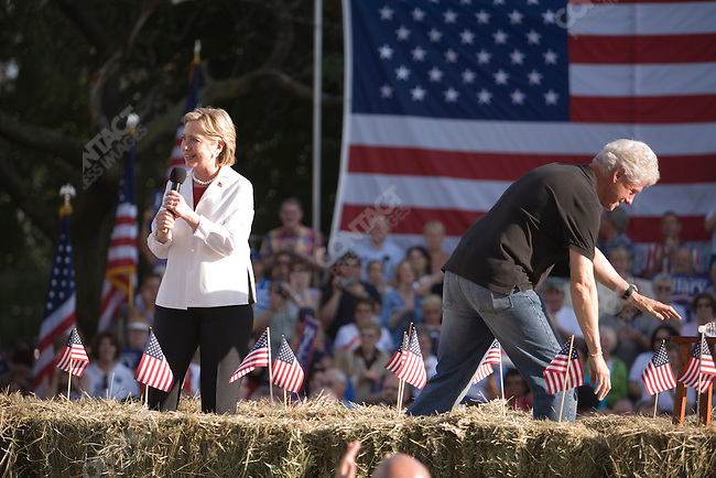 Senator Hillary Clinton (D-New York), potential Democratic Presidential candiate, and her husband, former U.S. President William (Bill) Clinton, attend a campaign rally. Cedar Rapids, Iowa, July 4, 2007.