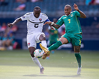 KANSAS CITY, KS - JUNE 26: Daneil Cyrus #5 and Keanu Marsh-Brown #7 contest the ball during a game between Guyana and Trinidad