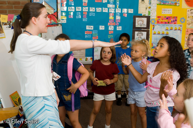 Schenectady, NY.Zoller School (urban public elementary school).Teacher leads students in song using hand motions..MR: AF-gKb.© Ellen B. Senisi