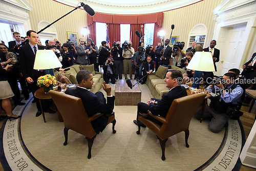 Prime Minister David Cameron of Great Britain, right, and United States President Barack Obama, left, meet in the Oval Office the White House in Washington, D.C. on Wednesday, March 14, 2012 following the Official Arrival Ceremony in Cameron's honor..Credit: Doug Mills / Pool via CNP