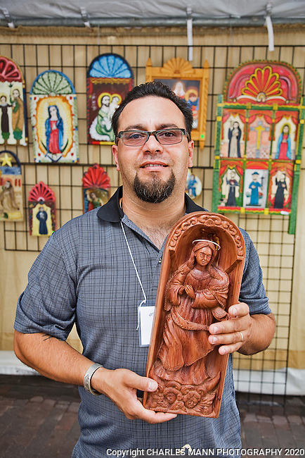 The Santa Fe Spanish Market, held in July, fills the Santa Fe Plaza with artists parton and visitors all celebrating traditional Spanish colonial arts. It is held side by side with the Contemporary Spanish Market which features modern Hispanic artists. Carver and painter Patricio Chavez won a blue ribbon for wood relief carving.