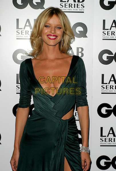 EVA HERZIGOVA.Arrivals - GQ Men Of The Year Awards,.Royal Opera House, Covent Garden, London,.England, September 5th 2006..half length green low cut dress slit split cleavage.Ref: AH.www.capitalpictures.com.sales@capitalpictures.com.©Adam Houghton/Capital Pictures.