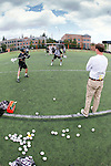 Orange, CA 05/16/15 - A Colorado coach monitors the warm up exercises before the start of the 2015 MCLA Division I championship game.