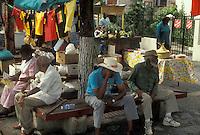 AJ2341, U.S. Virgin Islands, St. Thomas, Caribbean, USVI, U.S.V.I., Virgin Islands, Elderly people sitting under trees at a park in Charlotte Amalie on Saint Thomas Island, US Virgin Islands.
