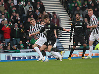 Charlie Mulgrew passing watched by Gary Teale (left) in the St Mirren v Celtic Scottish Communities League Cup Semi Final match played at Hampden Park, Glasgow on 27.1.13.