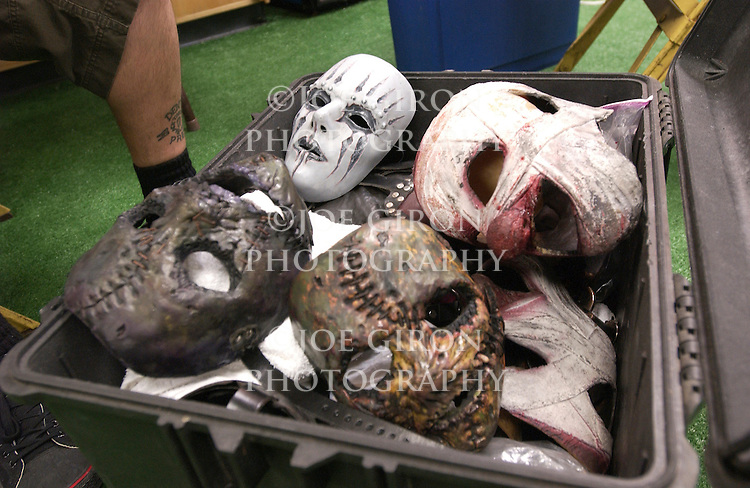Slipknot masks in a bin.