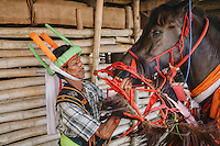 Johanes Ndara Kepala, a senior Pasola warrior, get his horse ready for the Pasola in Wainyapu, Kodi. Pasola is an ancient tradition from the Indonesian island of Sumba. Categorized as both extreme traditional sport and ritual, Pasola is an annual mock horse warfare performed in response to the harvesting season. In the battelfield, the Pasola warriors use blunt spears as their weapon. However, fatal accident still do occurs.