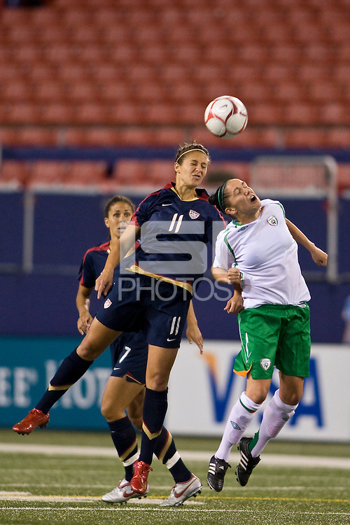 United States (USA) midfielder Carli Lloyd (11) and Republic of Ireland (IRL) defender Ciara McCormack (13). The women's national team of the United States (USA) defeated the Republic of Ireland (IRL) during an international friendly at Giants Stadium in East Rutherford, NJ on September 17, 2008. Photo by Howard C. Smith/isiphotos.com