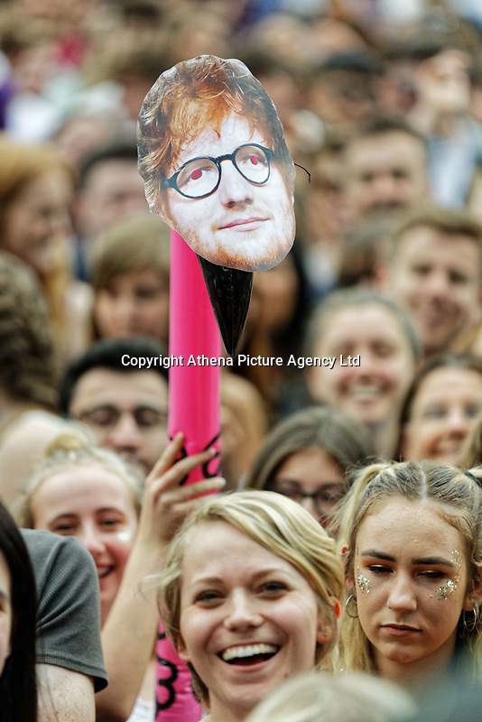 Pictured: A face cut out of Ed Sheeran held stuck on an inflatable swan in the crowd. Saturday 26 May 2018<br /> Re: BBC Radio 1 Biggest Weekend at Singleton Park in Swansea, Wales, UK.