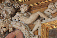 Ephebe in carved stucco from the frame of the frescoes the Education of Achilles and Giant by Rosso Fiorentino, 1535-37, in the Galerie Francois I, begun 1528, the first great gallery in France and the origination of the Renaissance style in France, Chateau de Fontainebleau, France. The Palace of Fontainebleau is one of the largest French royal palaces and was begun in the early 16th century for Francois I. It was listed as a UNESCO World Heritage Site in 1981. Picture by Manuel Cohen