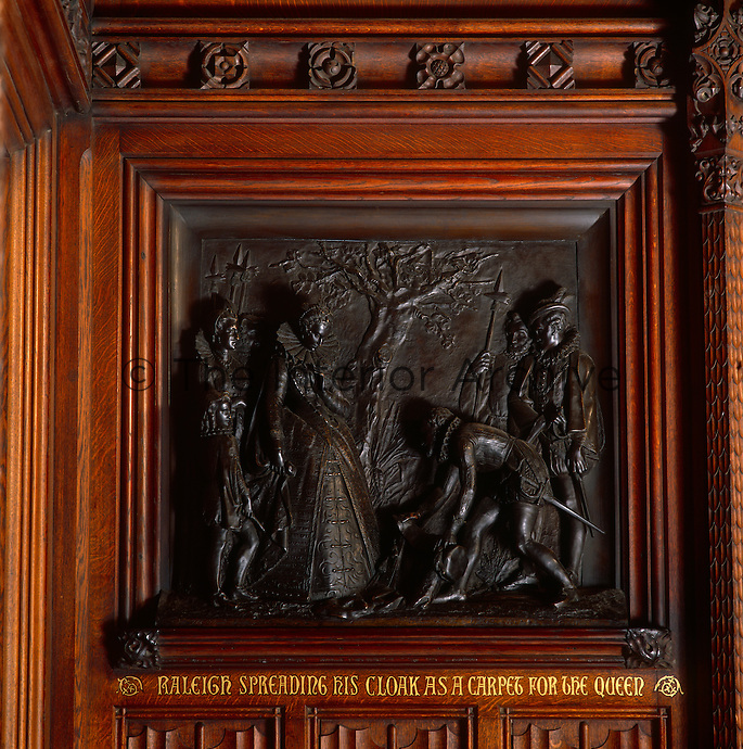 Detail of one of the bronze reliefs by William Theed in the Prince's Chamber. This panel depicts Raleigh spreading his cloak as a carpet for Queen Elizabeth I