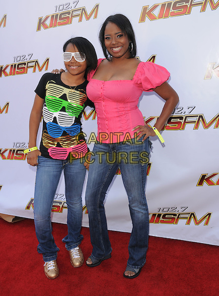 SHAR JACKSON & DAUGHTER CASSIE .at The KIIS Fm Wango Tango 2008 held at The Verizon Wireless Ampitheatre in Irvine, California, USA, May 10th 2008..music concert gig full length jeans white sunglasses print top t-shirt pink hand on hip mother family kid child gold trainers .CAP/EAS.©Eastman/Capital Pictures